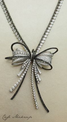 Chanel diamond bow necklace