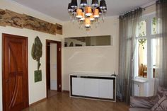 Apartment at 6 Nesterovskiy Lane Kiev Set in Kiev, this air-conditioned apartment is 1 km from Saint Sophia Cathedral. The apartment is 1.4 km from St. Volodymyr's Cathedral. Free WiFi is offered .  There is a dining area and a kitchen equipped with microwave.