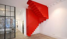 Designed by Diapo, the Hanging Red Stairs is made out of perforated steel mesh.