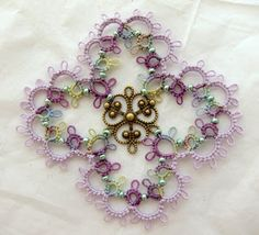 From Tat-ology's free patterns.  Some with beads and one with a metal filigree center.