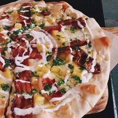 Thin crust pizza topped with creme fraiche, mozzarella, crispy bacon, pineapple & salsa verde.