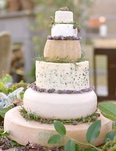 """a cheese wheel! Artisanal Cheese Wheel """"Cake"""" A great idea for cheese connoisseurs or perfect for a vineyard, garden, or farm wedding. Decorate the tiers with herbs, flowers, or various fruits. Wedding Cake Rustic, Wedding Cakes, Wedding Desserts, Herb Centerpieces, Wheel Cake, Naked Cakes, Wedding Cake Alternatives, Cake Photography, Wedding Photography"""