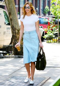 Karlie Kloss Found a New Way to Style a Denim Skirt via @WhoWhatWear