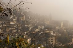 All will be revealed... - The historic town of Loreto Aprutino, in the Pescara province of Abruzzo Italy emerging from Autumn mist.