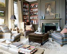 Painted paneling with pop of color in bookcase