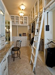 Library Ladder And Makeup Area Is Key To A Luxury Master Bedroom Closet