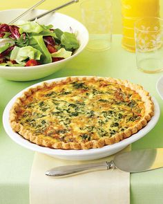 Spinach and Gruyere Quiche   Martha Stewart Living - Brunch isn't complete until a quiche steals the show. This variety combines spinach and Gruyere cheese with creamy egg custard and a buttery homemade crust.