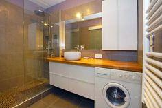 Wetroom with hidden washing machine great idea so no noise in kitchen