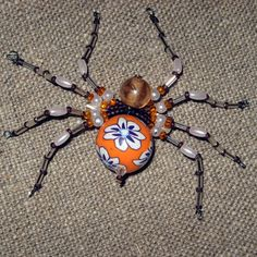 Spider pin or necklace hand made with beads - costume jewelry