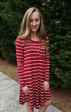 Such an easy look in this simply chic burgundy with ivory stripe swing dress.