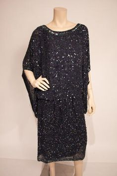 Short sleeve beaded dress - 92419 Short sleeve beaded dress   Our Price: $149.99