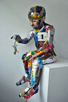 Dario Tironi, Italian Artist recycles found objects into colorful sculpture.