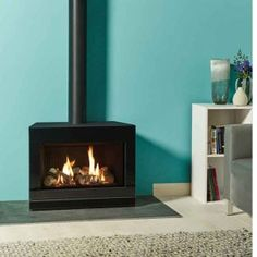 Offered in a stylish Graphite steel front, the Gazco Steel gas stove is a style alternative to the Glass model shown on the previous page and therefor Double Sided Stove, Wood Fireplace, Fireplaces, Modern Stoves, Multi Fuel Stove, Gas And Electric, Gas Fires, Gas Stove, Lounge