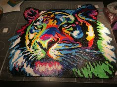Colorful tiger hama perler beads by Carina Bergenstoff Hama Beads Design, Diy Perler Beads, Perler Bead Art, Pearler Beads, Pixel Beads, Fuse Beads, Pearler Bead Patterns, Perler Patterns, Skins Minecraft