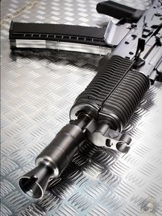 AK-47 assault rifle......this makes me hurt. It's clearly an ak74. Note the straighter mag, and muzzle brake.
