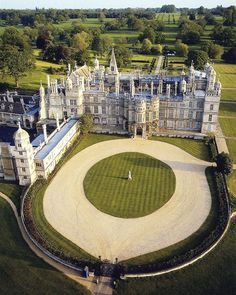Burghley House is a grand Elizabethan country house in Cambridgeshire, UK miles km) south of Stamford, Lincolnshire, England. Its park was laid out by Lancelot 'Capability' Brown. Beautiful Castles, Beautiful Buildings, Beautiful Places, Palaces, Peterborough England, Photo Chateau, Mansion Homes, English Manor, Photos Voyages