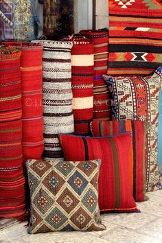 Beautiful collections of oriental red carpets and cushions in the Old City of Jerusalem.