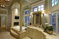 I would never leave this bathroom! Fireplace, tv, awesome tub filled with a hot bubble bath....ahhhh!