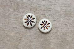 Ceramic pendant, glazed pendant, flower pendant, floral pendant, ceramic disc by BlackRabbitCeramics on Etsy Porcelain Clay, White Porcelain, Ceramic Pendant, Flower Pendant, Glaze, Pendants, Ceramics, Beads, Create
