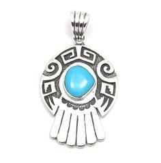 Stříbrný přívěsek s tyrkysem a ornamenty