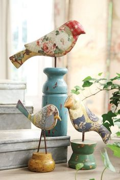 - The birds are wonderful though I do not know what they are made of. I love the different pedestals each bird is standing on. The green one looks like a yo-yo that has been taken apart and glued back together again with the outside pieces now facing each other.