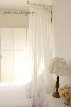 idea to use a bracket for a canopy over the head of the bed. easy and simple.