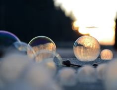 Angela Kelly | Sunrise | Caught in the very early stages of sunrise, a sea of frozen bubbles begin to glow.