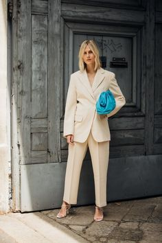 Le Fashion: Now This Is How You Wear a Power Suit for Summer —Photo via: Vogue Italy — How stunning is Linda Tol in this cool power suit look? The street style muse mastered the suit trend for summer by opting for an off-white set with a bold blue Bottega Veneta pouch bag, and strappy white sandals from The Row. We rounded up her exact look as well as some similar, more affordable options—Shop them all below.