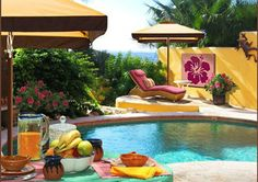 The poolside area at Posada Chabela is perfect for sunning, swimming, and al fresco dining.