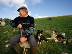 A farmer and his dogs rest for a moment in a County Mayo field. [Photo by Chris Rainier/National Geographic Stock]