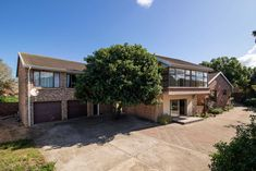This face brick family home is situated in Forest Downs, Port Alfred within walking distance from the Royal Port Alfred Golf Course and the beach. Spacious Living Room, Golf Courses, Cape, Brick, Home And Family, Real Estate, Holidays, Mansions, Street
