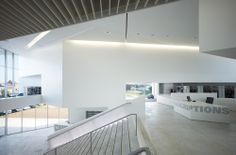 Library in Anzin / Dominique Coulon & Associés. Mez lfoor & wide steps to encourage movement onto 2nd level