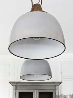 Two vintage ship lights, from Gaul Searson, add a few curves to all the straight lines. Design: Samantha Lyman.