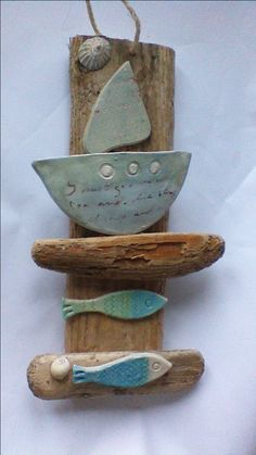 From Skellig Pottery. Local driftwood and ceramic fish and boats.