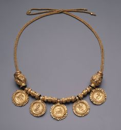 Or we can have an image and contour circle. Roman, Severan Necklace with imitation coin pendants, early century A. Gold Jewellery Design, Gold Jewelry, Jewelry Accessories, Fine Jewelry, Gold Necklace, Tiffany Jewelry, Ancient Jewelry, Antique Jewelry, Vintage Jewelry