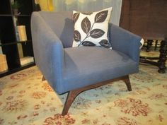 """Price: $249.99  Item #: 35835 Mid-century style chair with teak legs and a blue denim upholstery, 31""""wide x 33""""deep x 30'high."""