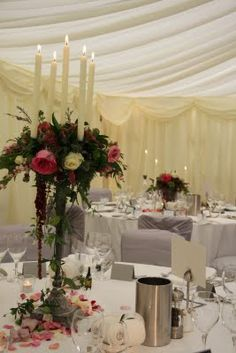 Tall table candelabras dripping with jasmine & Passion flowers