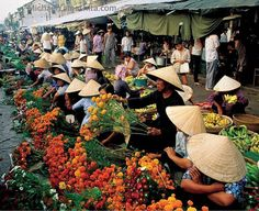 Photograph by Michael Yamashita. @yamashitaphoto - Vietnamese love for flowers is evident in this market in #cantho #Mekong Delta #vietnam #tet @thephotosociety @natgeocreative by natgeo