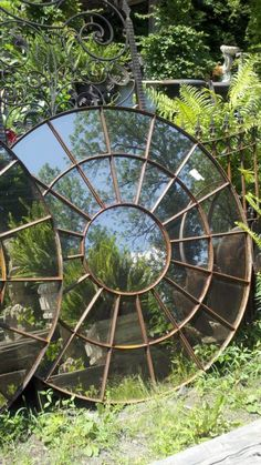 Antique Garden Mirror- love this! I think my balcony could use a big mirror on one side to reflect the light and make it brighter there