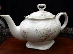 """Large Blue Sadler Teapot, 6 Cup Blue Wash Porcelain English Tea Pot. This is a lovely vintage teapot with Dogwood Rose design made by Sadler, England. It measures 9 1/2"""" long by 5 1/4"""" high and is in"""