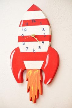 This whimsical clock would be perfect for a little boy's room, or baby boy's nursery. #decor #boy