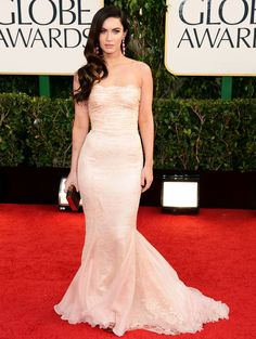 Megan Fox in a Dolce & Gabbana, blush lace strapless gown. She added Jimmy Choo heels and Lorraine Schwartz earrings. Fox carried a Salvatore Ferragamo clutch - Golden Globes 2013 Red Carpet