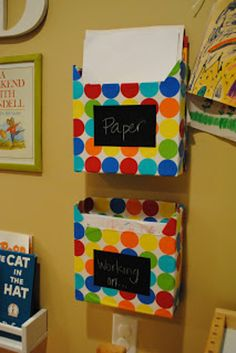 Cover cereal boxes with wrapping paper to make homework in/out bins. | 35 Money-Saving DIYs For Teachers On A Budget