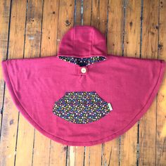 This listing is for a rose fleece Mini Cape/Poncho lined in grey sweatshirt jersey with a floral print pocket and hood lining. Size Large is already