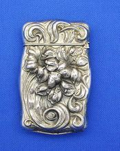 Sterling match safe, bold floral designs, by F. S. Gilbert
