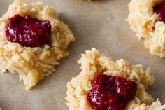 Coconut Macaroon Thumbprints with Raspberry Chia Seed Jam (Vegan + GF)  Read more: http://ohsheglows.com/2013/03/25/coconut-macaroon-thumbprints-with-raspberry-chia-seed-jam-vegan-gf/#ixzz2z5F2EuWz