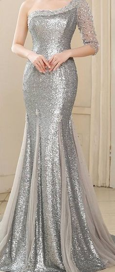Don't love the one-shoulder thing but do love the drape and partial sequinning of the skirt.