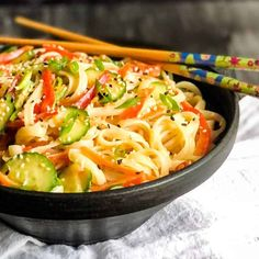 This Asian-inspired rice noodle salad is a refreshing side dish with bold flavors and a crunchy bite from the fresh vegetables. It's super versatile as vegetables can be interchanged according to what you have on hand. Serve it as a side dish, or add seared tofu or shrimp for a light dinner. #noodlesalad #freshsalad #easyrecipe #inspiredfreshlife
