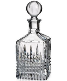 Waterford Crystal's Lismore Diamond decanter is a striking modern reinvention of the classic pattern. Its intricate diamond cuts sparkle radiantly.