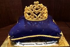 Baby Shower Royal Pillow and Crown. Almond Cake with butter cream frosting. Crown, ropes, tassels all fondant and gum paste.